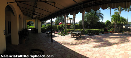 Keep cool in the shade. This seating area lies at the rear of the clubhouse adjacent to the pool area.